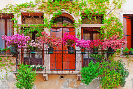 balcony door: Italian Windows with Balcony, Decorated With Fresh Flowers Stock Photo