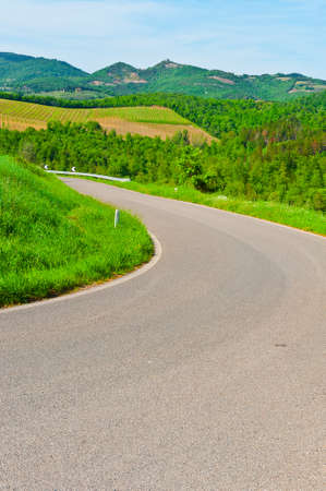 Winding Paved Road between Spring Plowed Fields  in the Tuscany photo