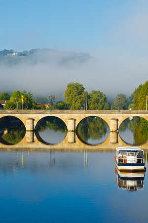 Morning Mist in the French City of Terrasson  photo