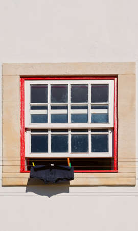 resplendence: The Men Underwear for Drying in Front of a Window Stock Photo