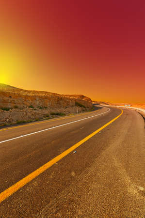 Asphalt Road in the Judean Desert on the West Bank, Sunset  photo
