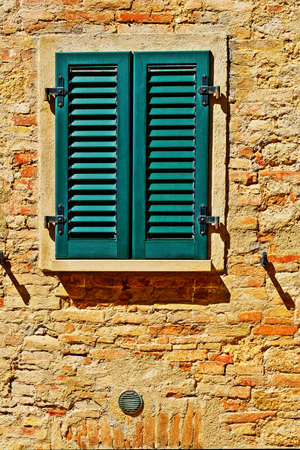 resplendence: Italian Window with Closed Wooden Shutters Stock Photo