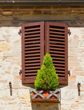renewed: Window on the Facade of the Restored Italian Home