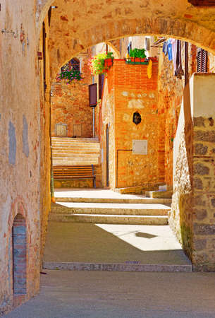 Narrow Alley with Old Buildings in Italian City  Stock Photo