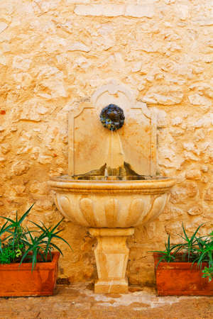 Old Drinking Fountain in France photo