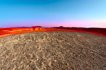 Sunset over the Stony Desert in Israel photo