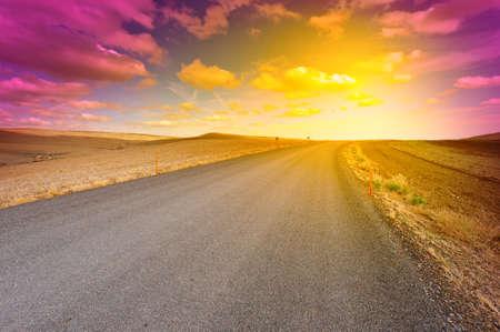 Winding carretera de asfalto en Espa�a, Puesta de sol photo