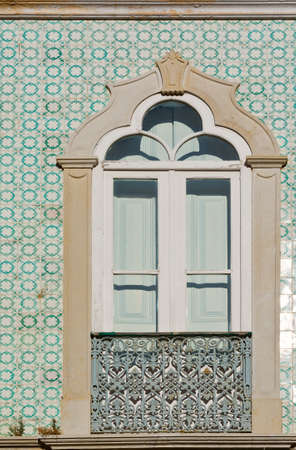 resplendence: Window Decorated with Portuguese Ceramic Tiles Stock Photo