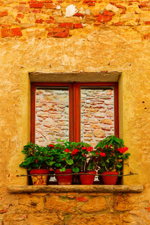 Italian Window  Decorated With Fresh Flowers
