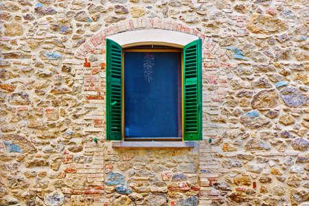 Italian Window with Open Wooden Shutters Standard-Bild