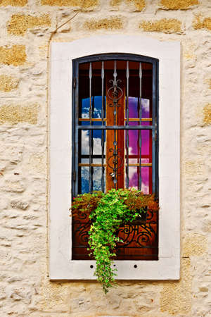 French Window  Decorated With Fresh Flowers Stock Photo