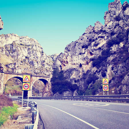 pyrenees: Railway Passing over the Highway in  Spain Stock Photo