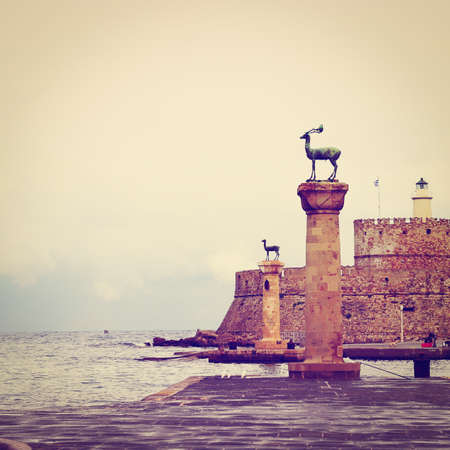 Harbor Gates and Lighthouse in Rhodes photo