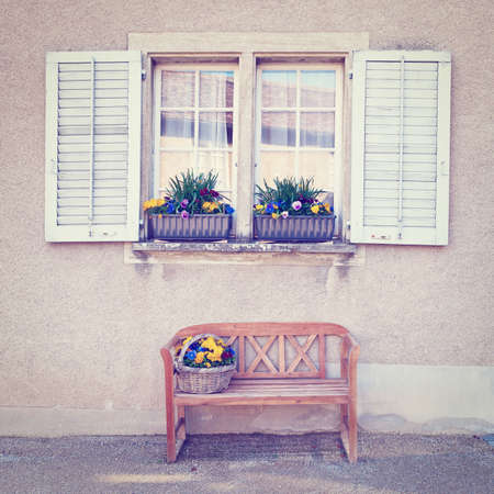 Wooden Bench for Rest under the Window, Instagram Effect photo