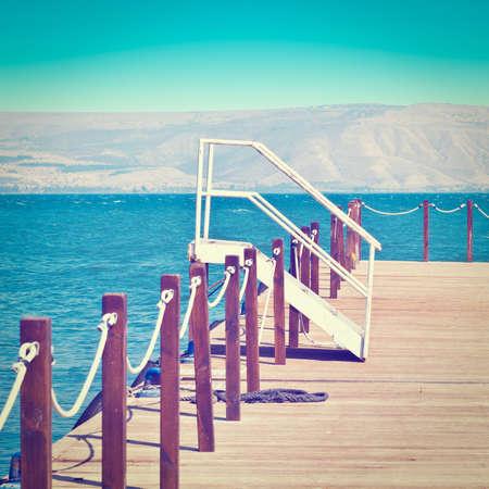 berth: Wooden Mooring Line on the Galilee Sea, Retro Effect Stock Photo