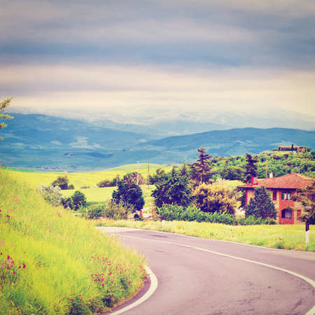 Asphalt Road Leading to the Farmhouse in Umbria, Retro Effect photo