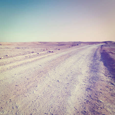 Dirt Road in the Judean Desert on the West Bank, Sunset, Retro Effect photo