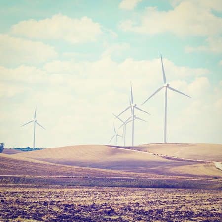 Modern Wind Turbines Producing Energy in Spain, Retro Effect photo