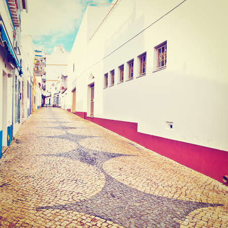Patterned Pavement in the Medieval Portuguese City of Logos, Retro Effect photo