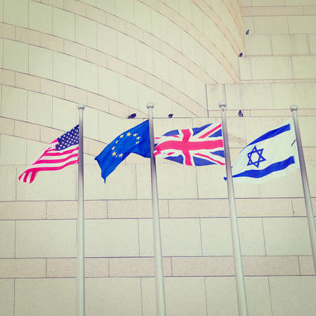 Flags US, UK, EU and Israel in Front of the Granite Facade, Retro Effect photo
