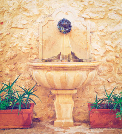 Old Drinking Fountain in France, Retro Effect photo