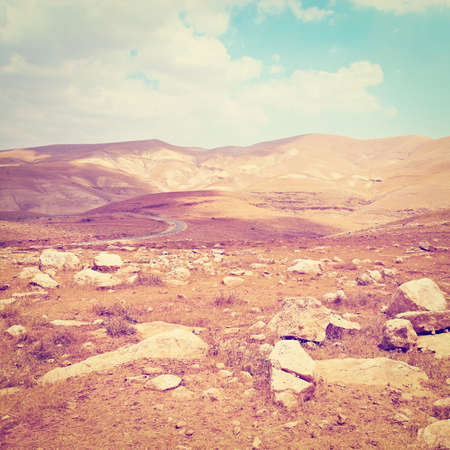 Meandering Road in Sand Hills of Israel, Retro Effect  photo