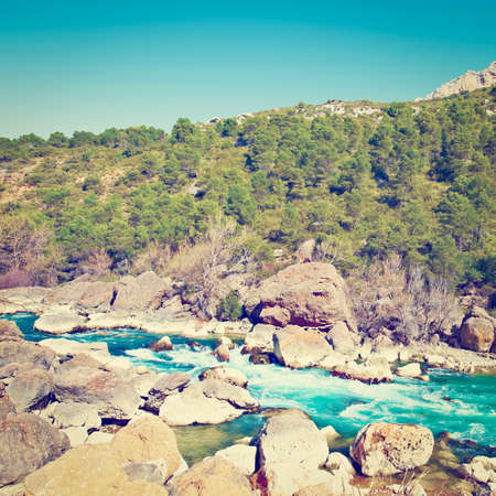 The Rapid Flow of the River Aragon in the Spur of the Pyrenees Mountains, Retro Effect photo