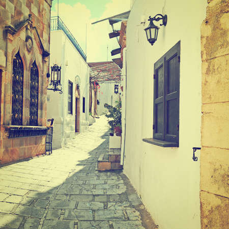 Narrow Alley with Old Buildings inl Greek City, Retro Effect photo