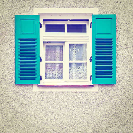 Typical Bavarian Window with Open Wooden Shutters, Retro Effect photo