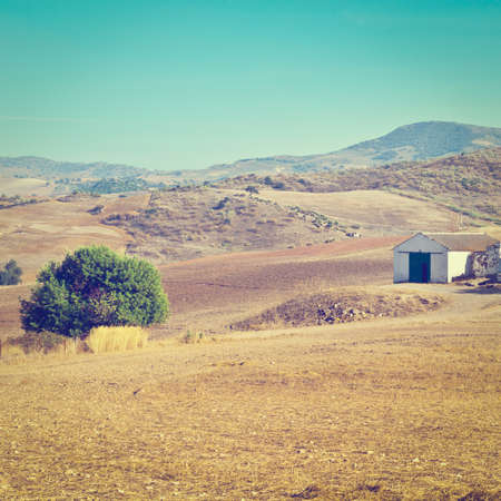 Farmhouse on the Plowed Ground in Spain photo