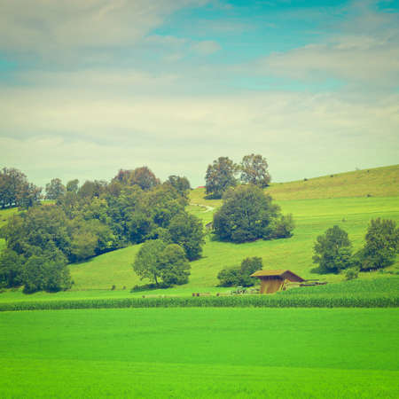 woodshed: Bavarian Landscape with Woodshed in Germany Stock Photo