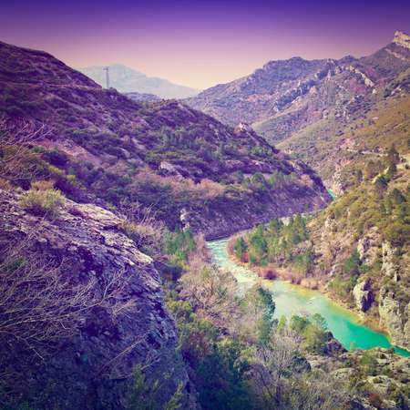 Rapid Flow of the River Aragon in the Spur of the Pyrenees Mountains, Sunset photo