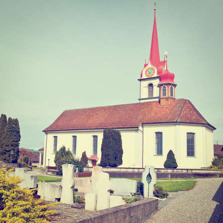 Christian Church with Clock Tower in Switzerland photo