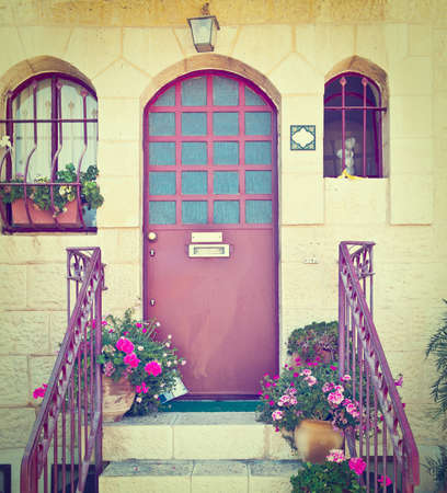 Detail of the Facade of Israel Home, Decorated with Flowers photo