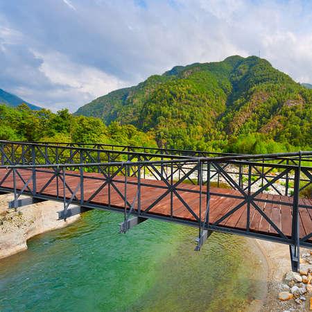 Bridge over the River in the Italian Alps photo
