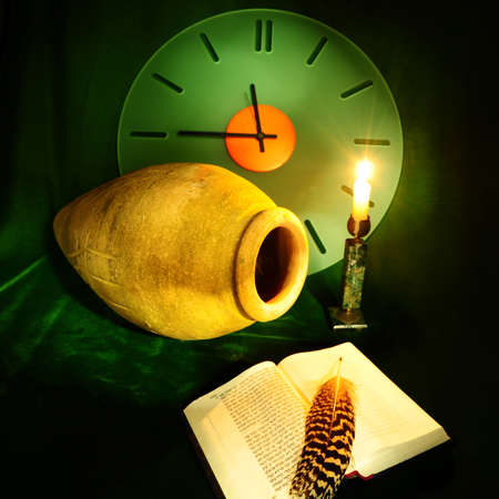Still Life with  Clock,  Amphora, Open Bible and  Lighted Candle on  Green Velvet photo