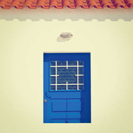 resplendence: Wooden Door in the White Wall of Portuguese Home