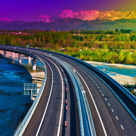 autobahn: The Modern Highway in Piedmont on the Background of Snow-capped Alps, Sunset