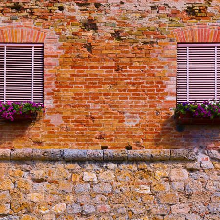 Italian Windows with Closed Shutters, Decorated with Fresh Flowers
