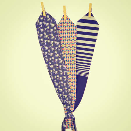 Three Ties Hanging on a Rope with Wooden Pegs