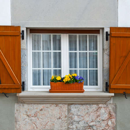 Spanish Window with Open Wooden Shutters, Decorated With Fresh Flowers photo