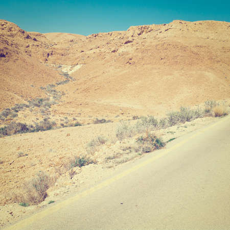 judean hills: Meandering Road in Sand Hills of Judean Mountains, Israel. Stock Photo