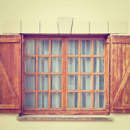 Closed Window with Shutter in Spanish Town. photo