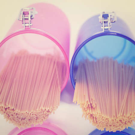 Pasta in Pink and Blue Glass Jar. photo