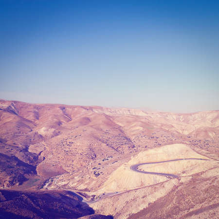 judean hills: Meandering Road in Sand Hills of Judean Mountain, Israel. Stock Photo
