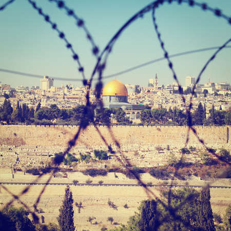 View From the Mount of Olives on the Dome of the Rock Through the Barbed Wire in Jerusalem, Israel. photo