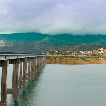 Bridge over Lake in the Cantabrian Mountains, Spain photo