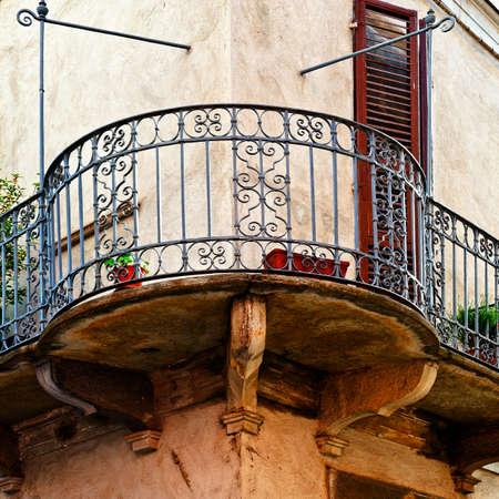 Facade of the Old Italian House with Balcony photo