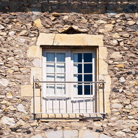 Window on the Facade of French Stone House. photo