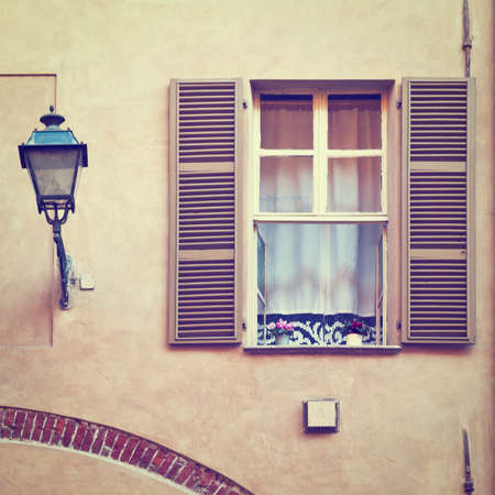 resplendence: Window on the Facade of the Restored Italian Home.